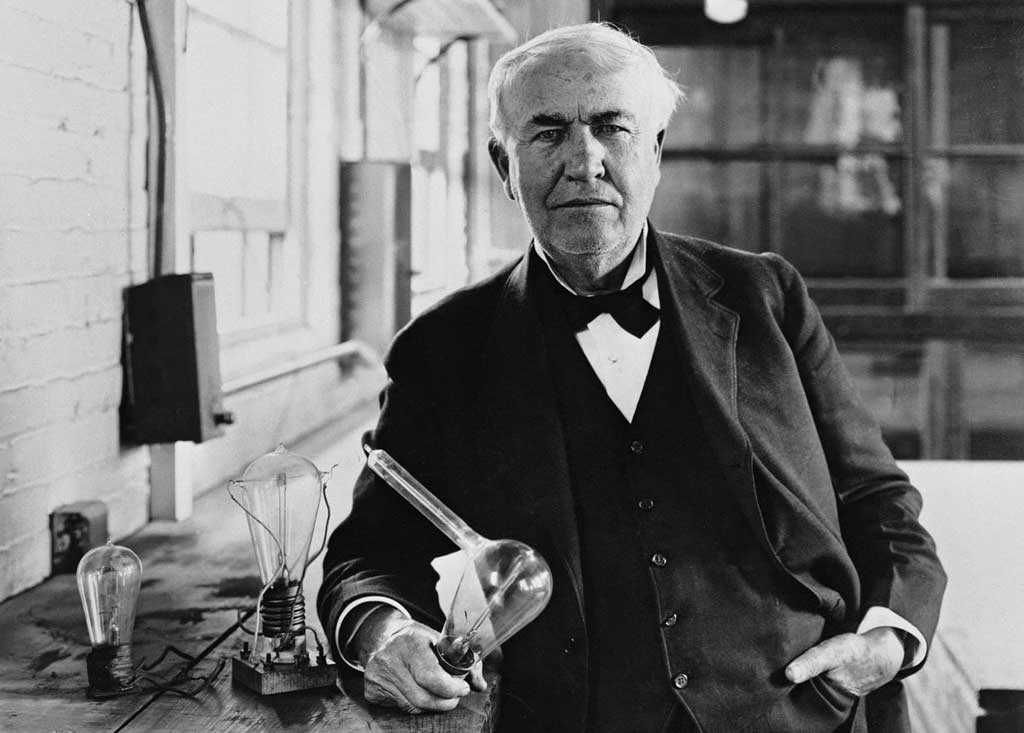 Edison with one of his early light bulbs